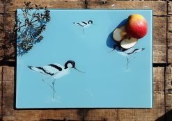 Avocet glass chopping board with sliced fruit