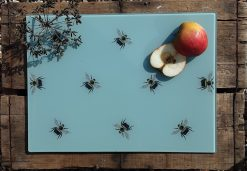 Bee glass chopping board with sliced fruit