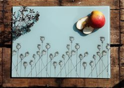 Poppy glass chopping board with sliced fruit